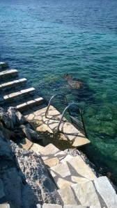 Steps into the beautiful water.